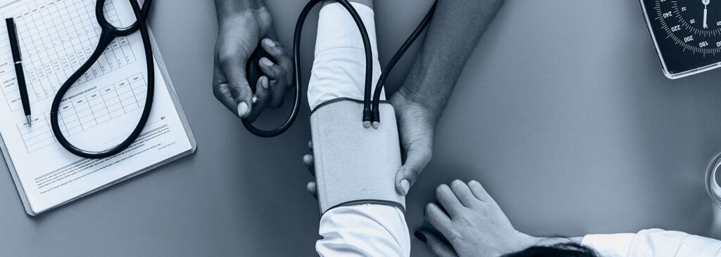 person getting blood pressure checked - What Doctor's Can Teach Us About Marketing hero image